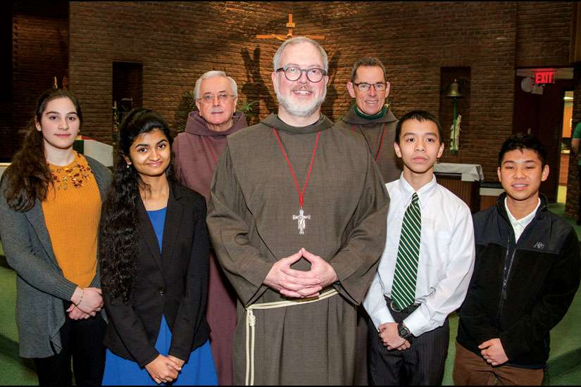 On Jan. 24, members of the Franciscan Friars of the Atonement-Graymoor honoured the winners of the Friars' Student Awards annual essay contest at a Mass at St. Joan of Arc parish in Toronto. Four of the six honoured were on hand, including, from left, second-place winner Raquel Seara, grand prize winner Sharanya Tiwari, third place winner Vincent Pham and honourable mention Brian Chen-See. Frs. Damian MacPherson, Brian Terry and Daniel Callahan, left to right, made the presentation.