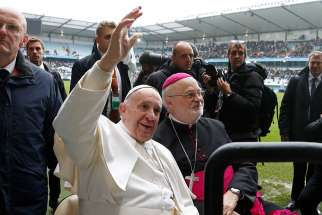 Pope Francis and Bishop Anders Arborelius of Stockholm ride in a golf cart as the pope greets the crowd before celebrating Mass in Malmo, Sweden, in this Nov. 1, 2016, file photo. Bishop Arborelius is among five new cardinals who will be created by the pope at a June 28 consistory.