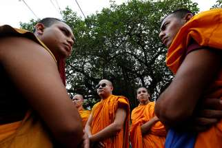 Buddhist monks participate in a protest against the murder of a monk in Bangladesh, in Mumbai, India, on May 23, 2016.