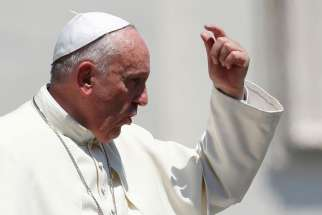 Pope Francis gestures as he leaves his general audience in St. Peter's Square at the Vatican June 10.