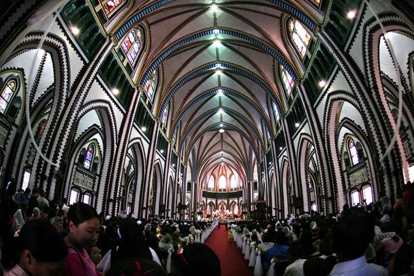 People gather inside St. Mary's Cathedral in 2011 in Yangon, Myanmar. Church sources say they expect Pope Francis to visit in late November.