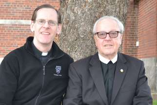 "Father Scott Bullock and Christian Brother Stephen Markham pose together in late March in Dubuque, Iowa, about nine months after kidney transplant surgery. ""It is without a doubt the greatest gift you can give anyone,"" Brother Markham said of the donated kidney he received from his priest friend."