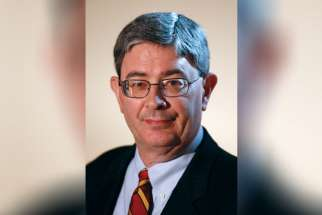 "George Weigel, a U.S. biographer of Pope John Paul II, is pictured in Rome Jan. 12. Weigel's latest book, ""The End and the Beginning: Pope John Paul II - The Victory of Freedom, the Last Years, the Legacy,"" is a sequel to his 1999 biography of the late pope. It adds new details about the church's struggle against communism and covers the last years of the pontiff's life."