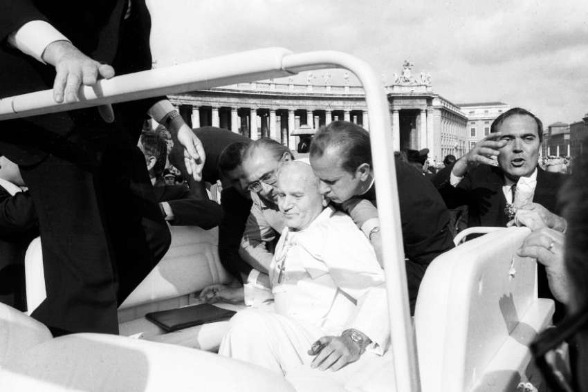 Pope John Paul II is assisted by aides after being shot in St. Peter's Square May 13, 1981.