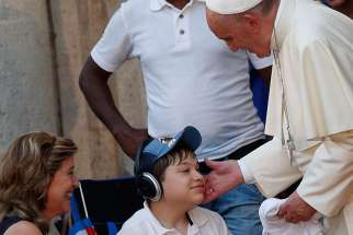Pope Francis blesses a boy with a disability at the Father Felix Varela cultural center in Havana Sept. 20.