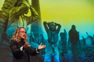 Photographer Lisa Kristine gives a presentation at St. Norbert College in De Pere, Wis., March 1, about her work photographing human trafficking around the world.