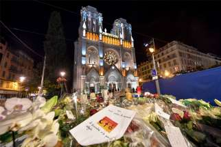 "Tributes to the dead are seen outside of Notre Dame Basilica in Nice, France, Nov. 1, 2020, as French bishops conduct a ""penitential rite of reparation,"" following the Oct. 29 deadly attack at church. The penitential rite was deemed necessary to purify the church from the stain of the homicide before normal religious activities could resume in the basilica."