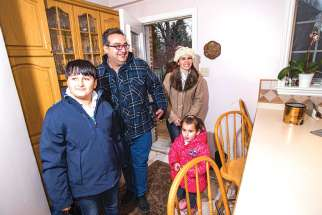 This refugee family from Aleppo, Syria, which did not wish to have its name published, is among the 25,000 refugees welcomed to Canada. As Catholics, we welcome the stranger, says Bishop Douglas Crosby.