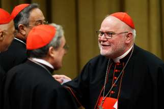 Cardinal Reinhard Marx of Munich-Freising, president of the German bishops' conference, arrives for a session of the Synod of Bishops on the family at the Vatican Oct. 23, 2015.