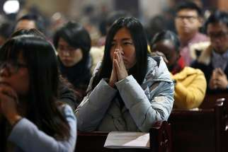 People pray during Mass in 2016 at the Cathedral of the Immaculate Conception in Beijing. A Chinese communist party official indicated July 19 that Beijing intends to retain tight grip on the Catholic Church.