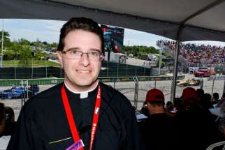 Fr. Jeff Calia at the Honda Indy in Toronto. The American priest is one of a half dozen priests who minister to drivers, crew and event staff on the IndyCar circuit.