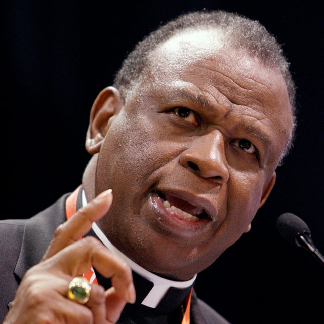 "Bishop Edward K. Braxton of Belleville denies ""firing"" a priest for using his own wording in some parts of the Mass."