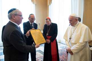 A representative of the American Jewish Committee gives Pope Francis a certificate March 8, 2019, certifying that a grapevine in Israel has been dedicated to him and promising that each year he will receive a bottle of wine produced with the vine's grapes.