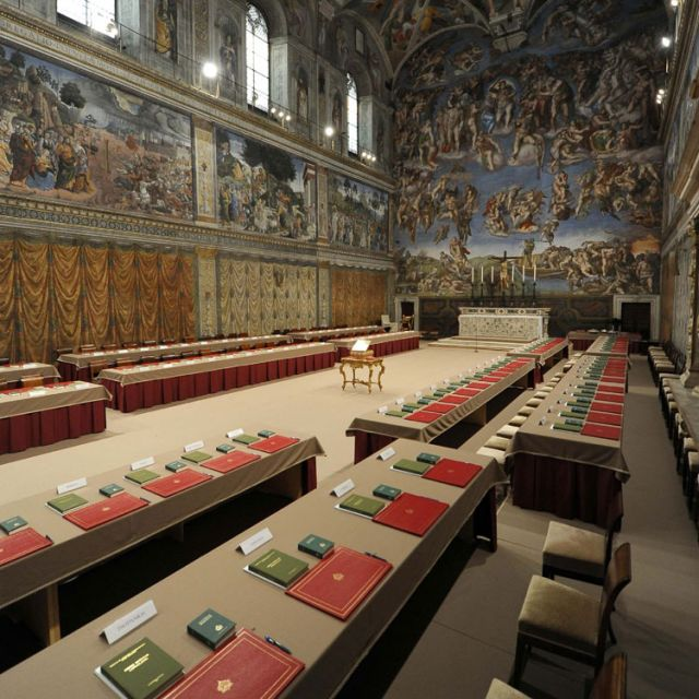 The Sistine Chapel is seen prepared with tables where cardinals will sit when the conclave begins in a picture released by L'Osservatore Romano March 12. The world's cardinals gathered in the chapel later that day for the conclave to elect a new pope.
