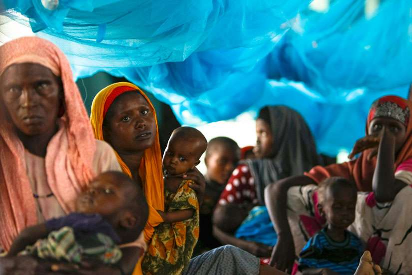 Somali refugees sit inside a tent in 2011 at the Ifo Extension refugee camp in Dadaab, Kenya, across the border from Somalia. Jesuit Refugee Service has urged Kenya to reconsider its plans to close camps that host hundreds of thousands of Somali and South Sudanese refugees.