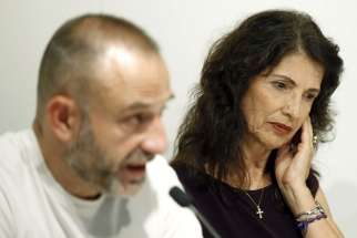 James Foley's mother, Diane Foley, right, sits next to El Periodico de Cataluna newspaper journalist Marc Marginedas during an Oct. 14 meeting of the Catalonian Journalist Association in Barcelona. The parents of slain U.S. journalist James Foley have re ceived an award on their son's behalf from the U.S. Institute of Peace.