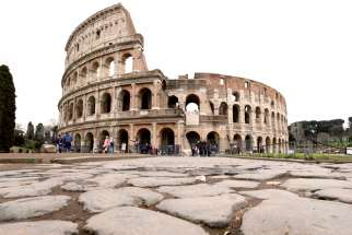 Very few people are seen in the area surrounding the Colosseum, which would usually be full of tourists, in Rome, March 2.