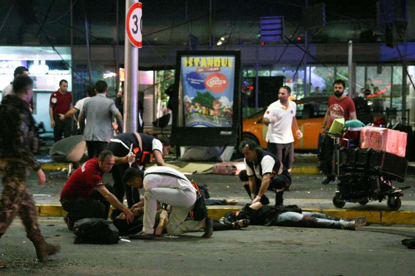 Paramedics help people outside Istanbul's Ataturk Airport following a June 28 suicide attack. The bombings killed dozens and wounded more than 200 as Turkish officials blamed the carnage at the international terminal on three suspected Islamic State group militants.