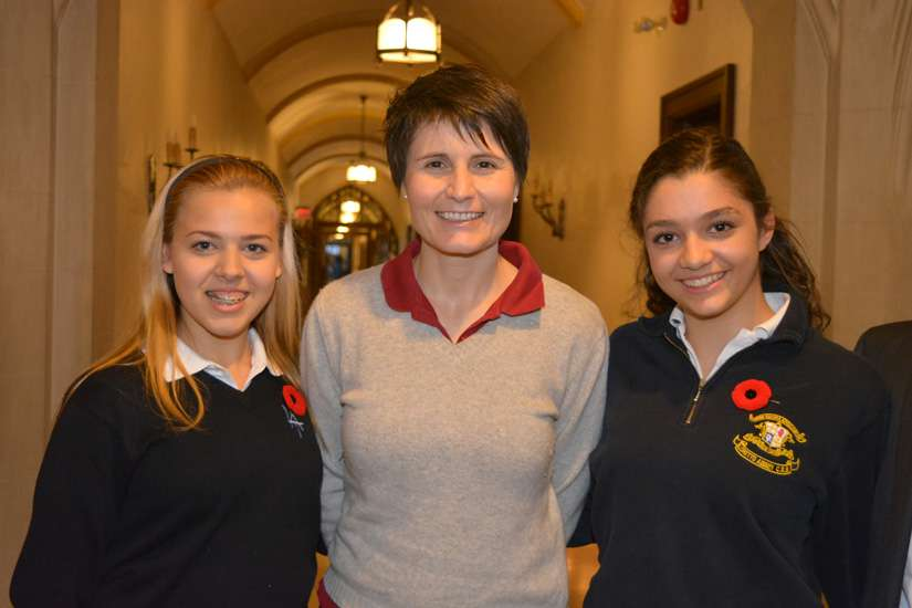 Italian astronaut Samantha Cristoforetti poses with two students during her visit to Loretto Abbey Catholic Secondary School.