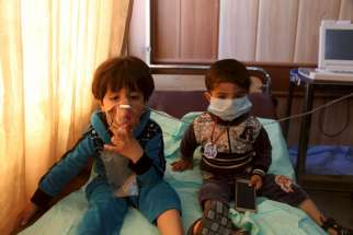 "Children receive oxygen at a hospital in Taza, Iraq, March 9, after Islamic State militants fired mortar shells and rockets filled with ""poisonous substances"" into their village."