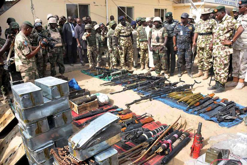 Nigerian President Goodluck Jonathan and military inspect weapons seized by Islamic militants in Baga, Nigeria, in this Feb. 26, 2015, file photo.