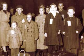 Hungarian refugees arrive in Canada in 1957, fleeing from Communist rule in their homeland.