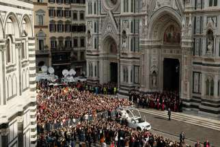 Pope Francis leaves the Duomo, the Cathedral of St. Maria del Fiore, in Florence, Italy, Nov. 10. Pope Francis attended a meeting of Italy's bishops and cardinals in the Duomo during a one-day visit to Florence Nov. 10. The pope also met young people and was to celebrate Mass at a soccer stadium.