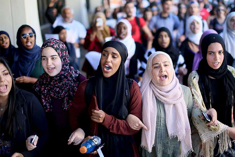 Students chant while marching at a rally against Islamophobia at San Diego State University in San Diego, Calif., on November 23, 2015.