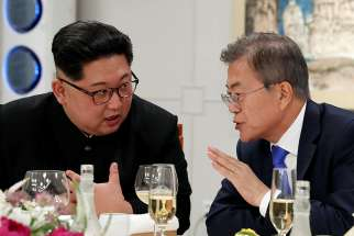 South Korean President Moon Jae-in and North Korean leader Kim Jong Un attend a banquet inside the demilitarized zone separating the two Koreas April 27.