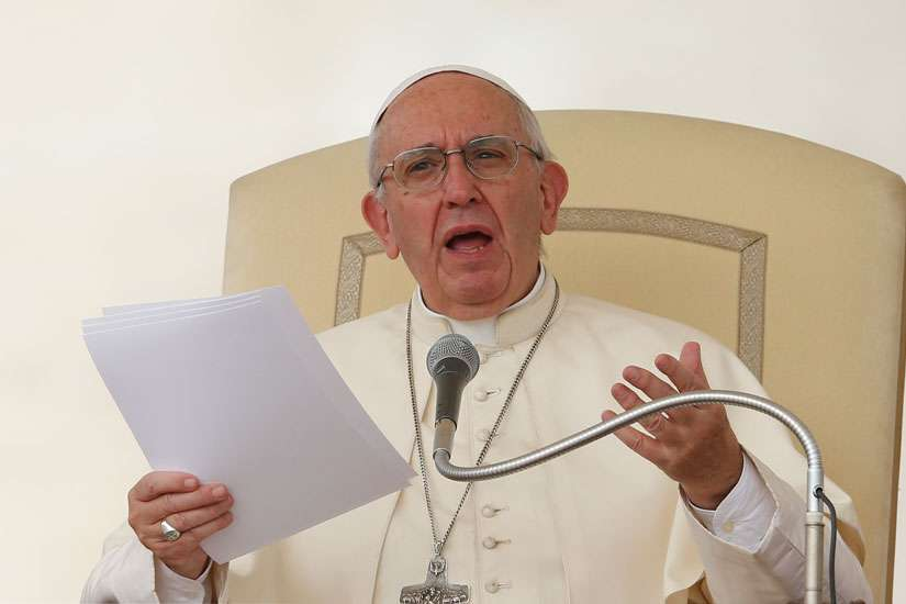 Pope Francis speaks during his general audience in St. Peter's Square at the Vatican Aug. 31.