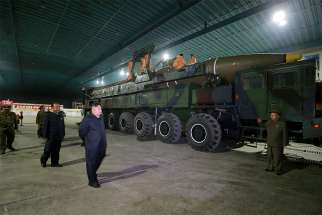 North Korean leader Kim Jong Un inspects the intercontinental ballistic missile Hwasong-14 in this undated photo released by North Korea's Korean Central News Agency.