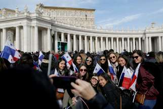 Students from Panama pose for a photo as Pope Francis leads the Angelus Jan. 22 in St. Peter's Square at the Vatican.