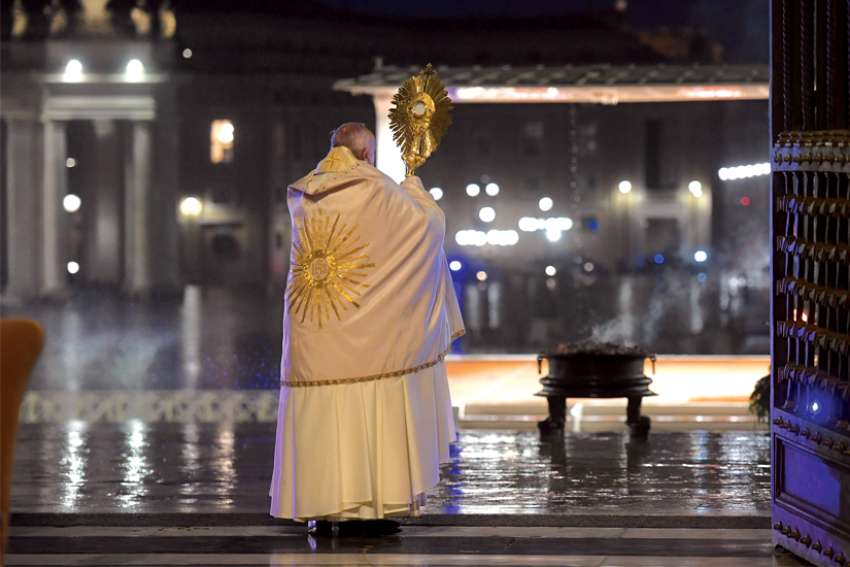 "Pope Francis holds the monstrance as he delivers his extraordinary blessing ""urbi et orbi"" (to the city and the world) on March 27."