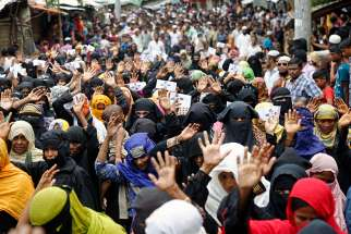 A group of Rohingya refugee women participate in an Aug. 25 protest to mark Rohingya Genocide Remembrance Day at a camp in Cox's Bazar, Bangladesh. A U.N. fact-finding mission said senior military officials in Myanmar must be prosecuted for genocide and war crimes against Rohingya Muslims and other ethnic minorities.