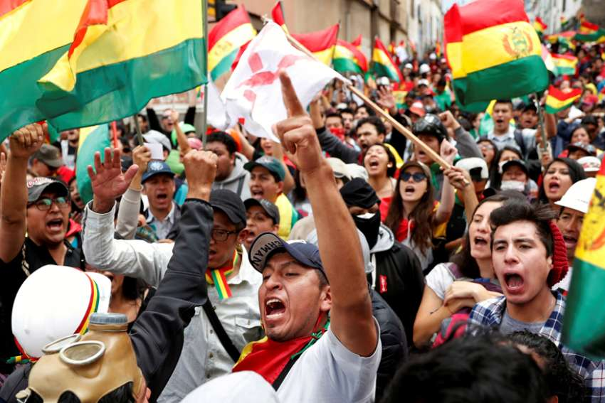 People in La Paz, Bolivia, shout slogans Nov. 9, 2019, during a protest against Bolivia's President Evo Morales. Morales resigned Nov. 10 after nearly 14 years in office.