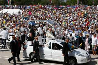 Pope Francis arrives to celebrate Mass in Revolution Square in Holguin, Cuba, Sept. 21.