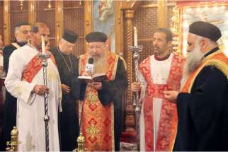 Coptic Orthodox priests in Amman, Jordan, remember 21 murdered Egyptian Christians during a Divine Liturgy Feb. 18. The Coptic Christians were beheaded by Islamic State militants in Libya, where the Egyptian nationals had been working.