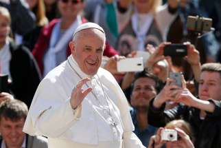 Pope Francis greets the crowd during his general audience in St. Peter's Square at the Vatican May 3.