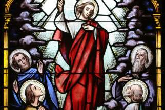 Christ's ascent to heaven is depicted in a stained-glass window at St. Therese of Lisieux Church in Montauk, N.Y.