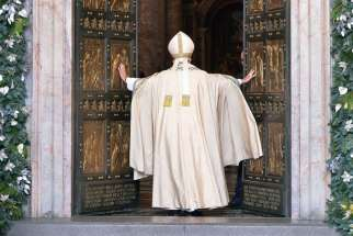 Pope Francis opens the Holy Door of St. Peter's Basilica to inaugurate the Jubilee Year of Mercy at the Vatican Dec. 8.