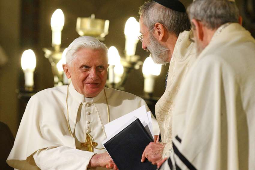 Pope Benedict XVI greets Rabbi Riccardo Di Segni, the chief rabbi of Rome, during his visit to the main synagogue in Rome in this 2010 file photo. The now retired pontiff sent a letter correcting a German theologian who implied that Pope Benedict encouraged the evangelization of the Jewish people as a mission.