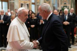 Pope Francis greets Supreme Knight Carl A. Anderson of the Knights of Columbus during an audience with a delegation from the Knights at the Vatican Feb. 10, 2020. Members of the Knight's board of directors were in Rome to celebrate the 100th anniversary of the organization's active presence in Rome.