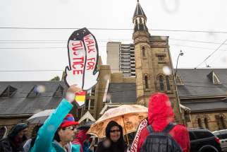 Indigenous Canadians call for the acknowledgement of their suffering at a Toronto march in 2015.