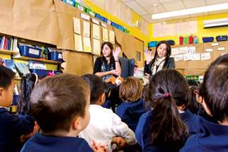 Anna Pechia (left) and Claudia Taborda teach kindergarten in the library at St. Paschal Baylon School in Toronto.