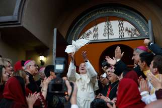 Pope Francis releases a dove after a meeting with Chaldean Catholics at the Church of St. Simon the Tanner in Tbilisi, Georgia, Sept. 30.