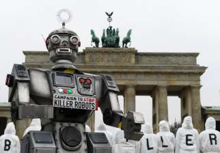 Activists from the Campaign to Stop Killer Robots, a coalition of nongovernmental organizations opposing lethal autonomous weapons, protest at the Brandenburg Gate in Berlin March, 21, 2019.