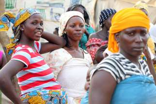 "Internally displaced women gather in early February at New Kichigoro camp outside Abuja, Nigeria. People displaced through violence ""are extremely vulnerable to trafficking,"" said Albert Mashika, regional coordinator for Caritas Africa."