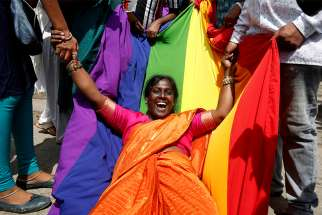 A LGBT supporter in Bengaluru, India, celebrates Sept. 6 after the country's Supreme Court decriminalized homosexual acts between consenting adults.