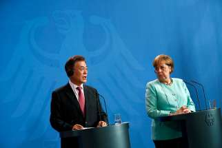 South Korean President Moon Jae-in is seen with German Chancellor Angela Merkel in Berlin July 5. The Catholic Bishops' Conference of Korea welcomed Moon's peace initiative with North Korea, saying it matches the church's views on how peace can be achieved in the region.