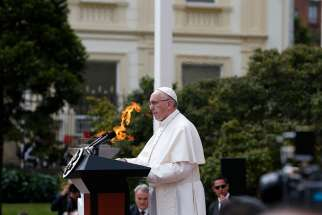 Pope Francis addresses the audience during a meeting with Colombian President Juan Manuel Santos and other government authorities in the courtyard of the presidential palace in Bogota, Colombia, Sept. 7.